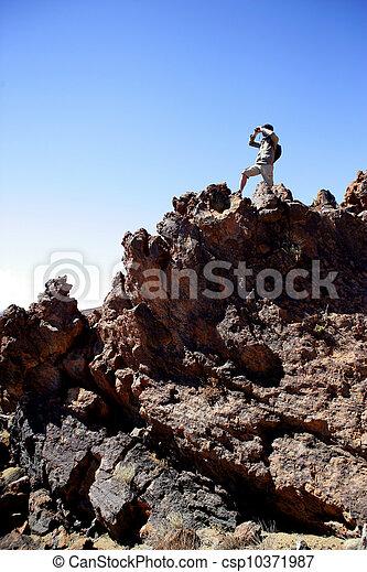 Hiker looking through binoculars - csp10371987