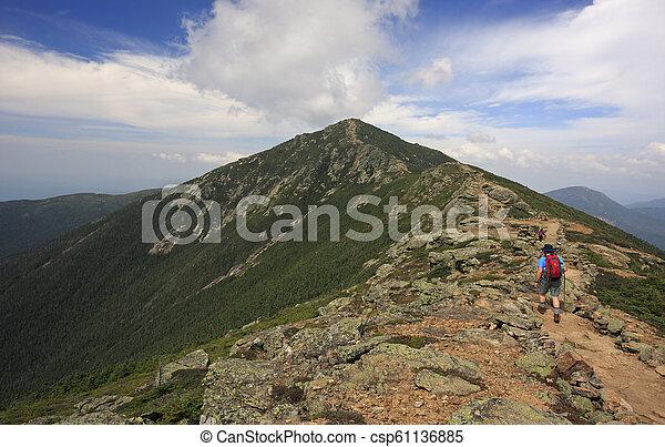 Hiker Trekking Along Franconia Mountain Ridge Traverse With A Beautiful Landscape Background Mount Lafayette Mount Lincoln