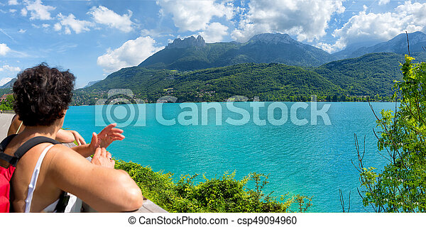 hiker woman watching view of Lake Annecy - csp49094960