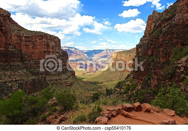 Hiking a trail in the Grand Canyon Arizona - csp55410176