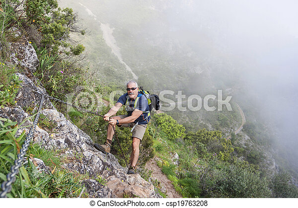 Hiking in the mountain - csp19763208