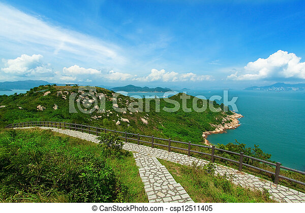 Hiking path surrounded by the sea  - csp12511405