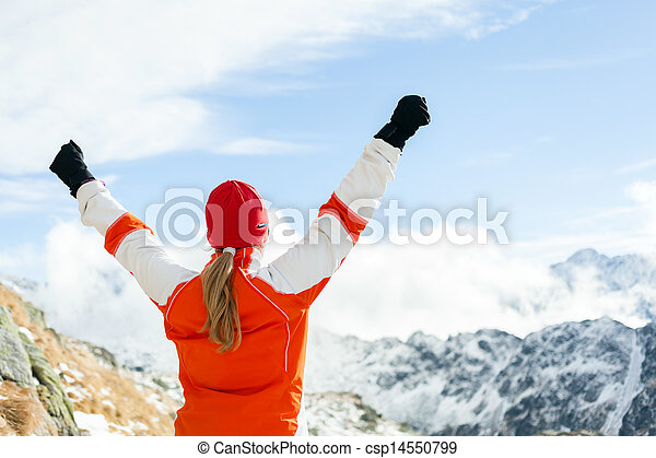 Hiking success, woman in winter mountains - csp14550799
