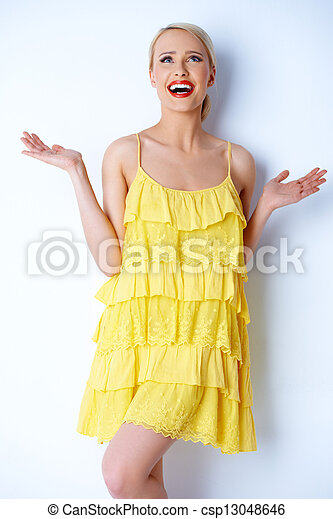 Hilarious blond woman posing over white - csp13048646