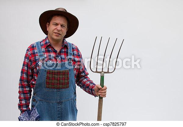 Hillbilly or farmer with pitchfork. - csp7825797