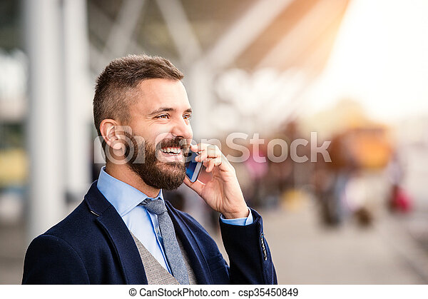 Hipster businessman making phone call waiting at the airport - csp35450849