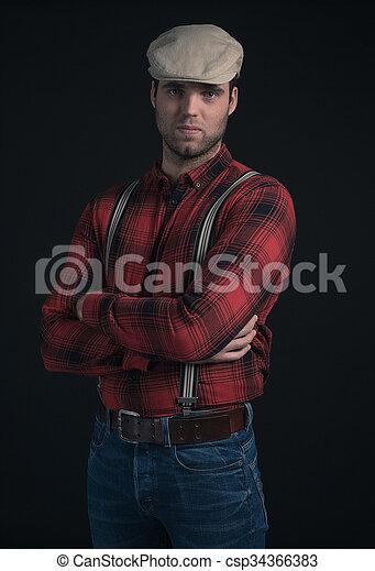 93b9b16079 Hipster lumberjack fashion man wearing red checkered shirt and cap. -  csp34366383