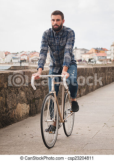 Hipster Man Riding In A Fixie Bike Hipster Man Riding In A