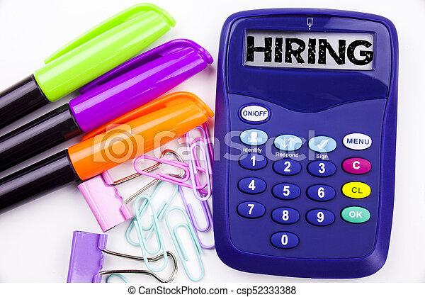 Hiring text in the office with surroundings such as marker, pen writing on calculator. Business concept for Recruitment and Job recruiting advertisement white background with copy space - csp52333388