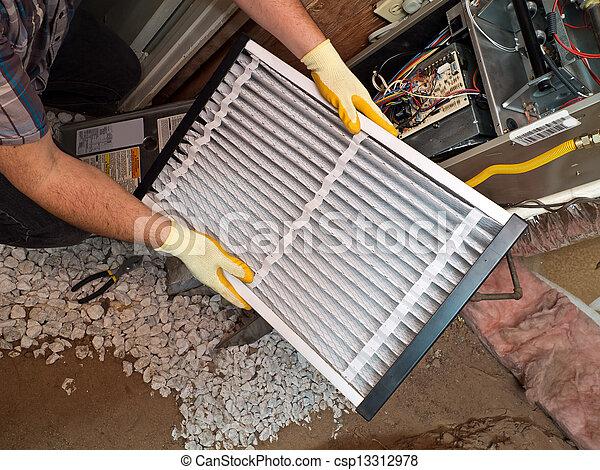 Hispanic air conditioning repair man performing maintenance - csp13312978