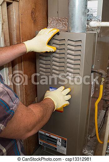 Hispanic air conditioning repair man performing maintenance - csp13312981