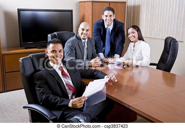 Hispanic business people meeting in boardroom - csp3837423