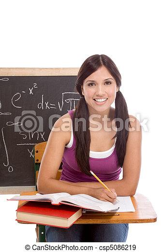 Hispanic college student woman studying math exam - csp5086219
