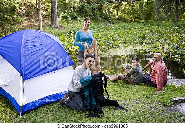 Hispanic family camping - csp3961065