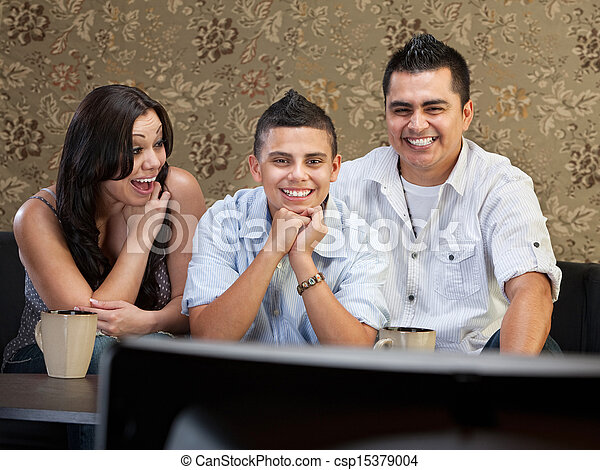 Hispanic Family Enjoying TV - csp15379004