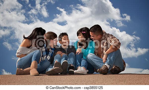 Hispanic Family Looking at Young Son - csp3855125