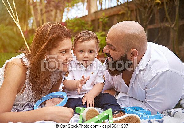 Hispanic family of three - csp45041337