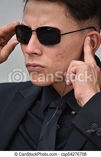 fa10c43812ae Hispanic Fbi Agent Listening Wearing Sunglasses - csp54276708