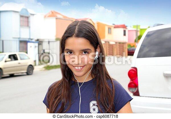 hispanic latin teenager girl earphones music - csp6087718