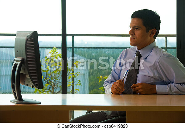 Hispanic Male Executive Office Looking Monitor - csp6419823