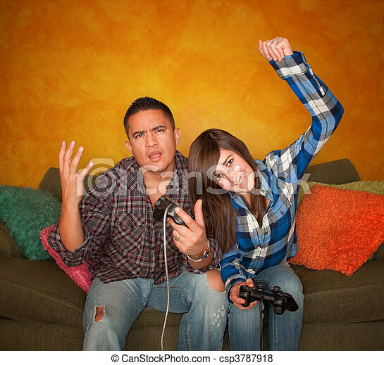 Hispanic Man and Girl Playing Video game - csp3787918