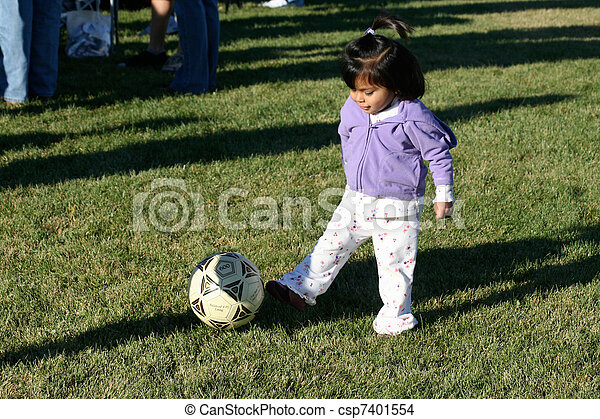 Hispanic toddler playing soccer - csp7401554