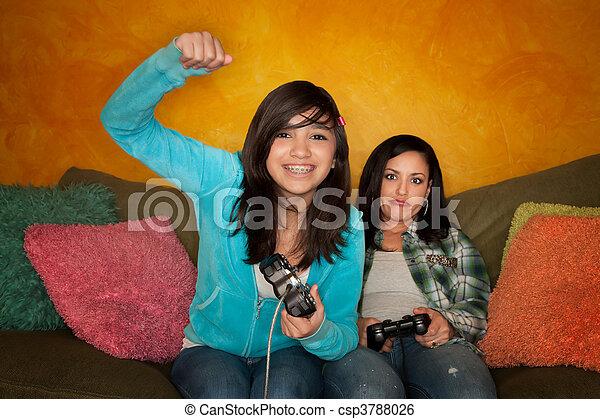 Hispanic Woman and Girl Playing Video game - csp3788026