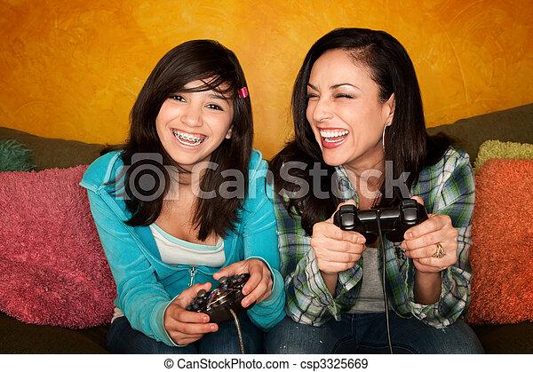 Hispanic Woman and Girl Playing Video game - csp3325669