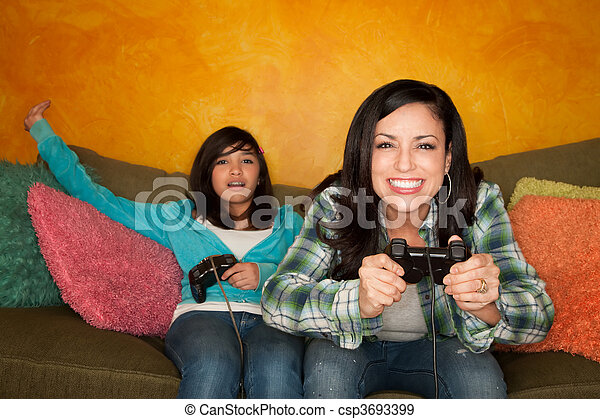 Hispanic Woman and Girl Playing Video game - csp3693399