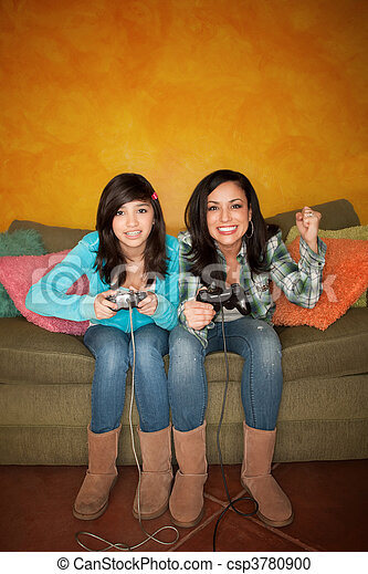 Hispanic Woman and Girl Playing Video game - csp3780900