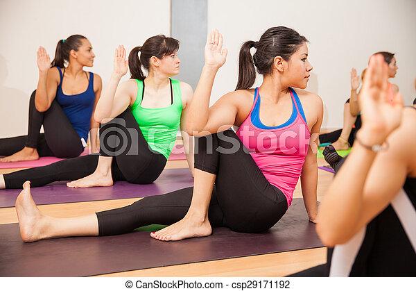 hispanic women in a yoga class group of young hispanic