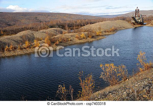 Historic Alaska Gold Dredge in Fall - csp7403318