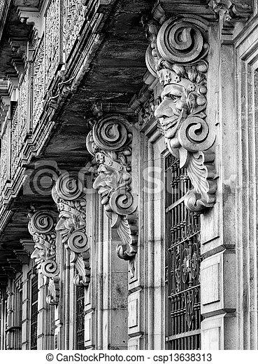 Historic building facade with masks - csp13638313