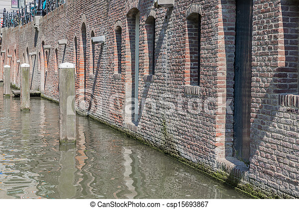 Historic canal houses in medieval city Utrecht of the Netherlands - csp15693867