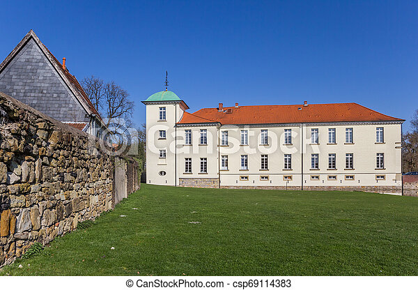 Historic castle in the Old Village of Westerholt - csp69114383