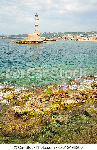 Historic lighthouse and sea in Chania harbor in Crete - csp12492280