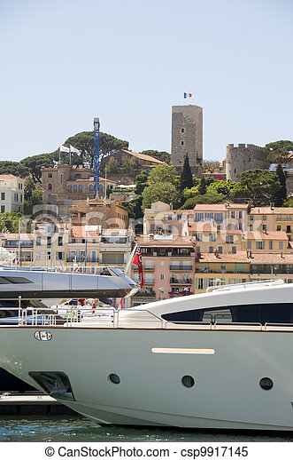 historic Old City fortress  from the harbor with yachts Cannes French Riviera Cote d'Azur Cannes France - csp9917145