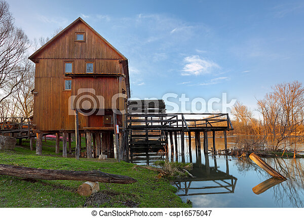 Historic wooden watermill with reflection. - csp16575047