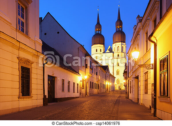 Historical street in Trnava with Saint Nicolas church Slovakia - Eastern Europe - csp14061976