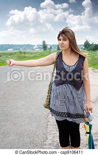Hitchhiking Girl - csp9106411