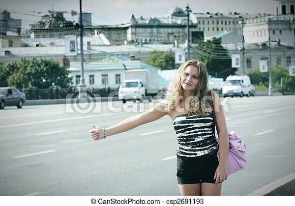 Hitchhiking girl with pink bag - csp2691193