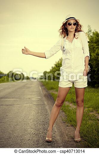 hitchhiking young woman - csp40713014
