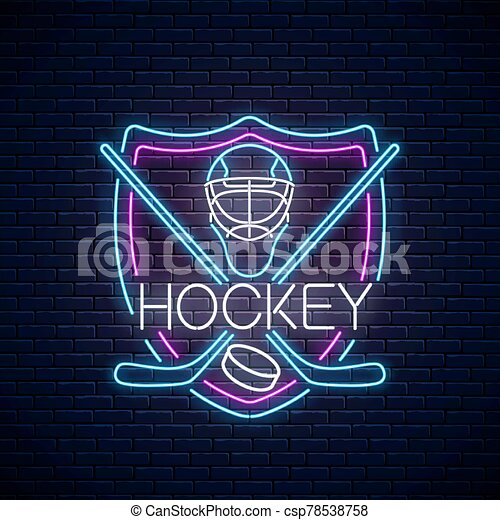 Hockey championship neon sign with hockey sticks, puck and goalkeeper helmet in shield frame Ice hockey competition logo - csp78538758