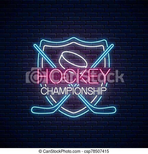 Hockey championship neon sign with hockey sticks and puck. Ice hockey competition logo, emblem, symbol design. - csp78507415