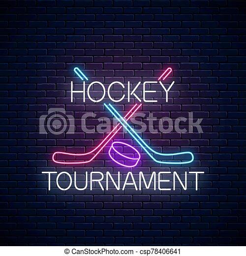 Hockey tournament neon sign with hockey sticks and puck. Ice hockey competition logo, emblem, symbol design. - csp78406641