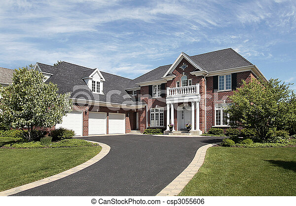 Una casa lujosa de ladrillos suburbanos - csp3055606