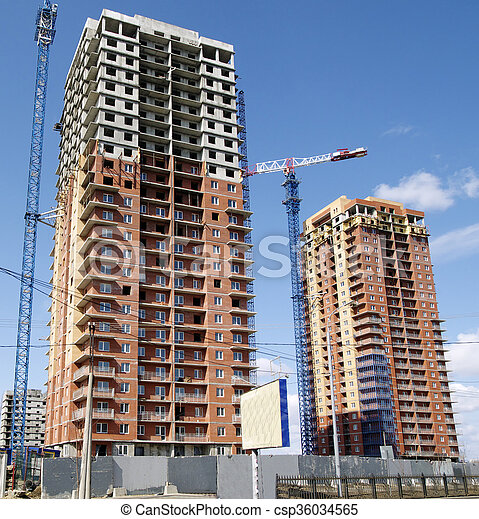 Hoisting crane and house construction - csp36034565