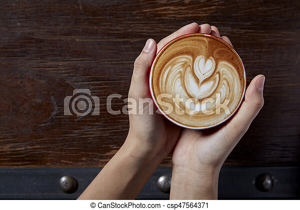 Holding a cup of coffee - csp47564371