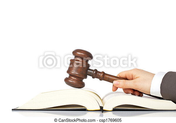Holding a wooden gavel over the law book - csp1769605