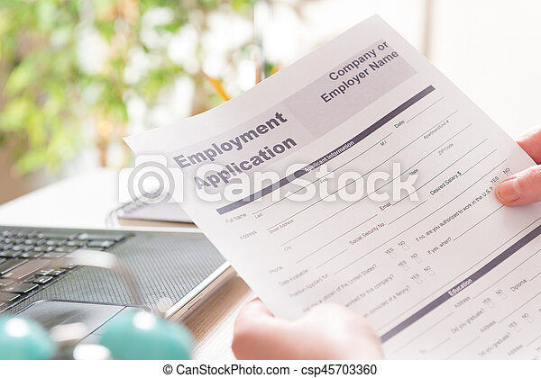 Holding blank employment application form - csp45703360